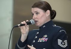 Tech. Sgt. Paige Wroble, U.S Air Force Band's Airmen of Note vocalist, sings at the National Museum of American History in Washington, D.C., Dec. 3, 2016. The group played holiday favorites throughout the afternoon for museum visitors to spread cheer during the season. (U.S. Air Force photo by Senior Airman Jordyn Fetter)