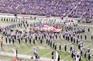 """The American flag is unfurled at a half-time show at Bill Snyder Family Stadium during the Fort Riley Day military appreciation game Nov. 5. Members of the 1st Infantry Division opened and waved the flag while the Kansas State University Marching Band played both the Army Song and """"Big Red One"""" Song."""