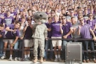 """Willie the Wildcat, donning an Army uniform, poses with Kansas State University fans during a football game between the Wildcats and the Oklahoma State University Cowboys Nov. 5 at Bill Snyder Family Stadium in Manhattan, Kansas. The game recognized Fort Riley Day and the partnership between the university and the """"Big Red One."""""""