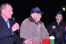 City of Omaha Parks and Recreation director Brook Bench (left), and Offutt AFB's 55th Wing commander Col. Marty Reynolds, right accompanied World War II veteran Bill Wood as he pushed the switch to light up the display at the 'Veterans Shine On' ceremony at Memorial Park in Omaha, Nebraska on Dec. 2. (U.S. Air Force photo by D.P. Heard)