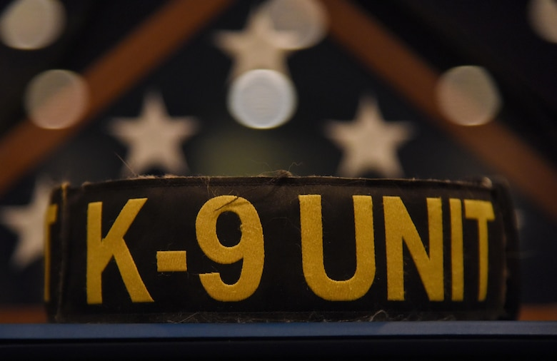 A K-9 Unit dog collar sirs on display during a retirement ceremony for Densy and Ares, 81st Security Forces Squadron military working dogs, at the Keesler Medical Center Don Wylie Auditorium Dec. 2, 2016, on Keesler Air Force Base, Miss. Densy and Ares served more than 17 years combined in the Air Force. (U.S. Air Force photo by Kemberly Groue)