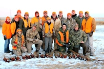Terry Ness (back row center) and retired Lt. Col. Gerald Walzel (fourth front row) provided Airmen and their families an opportunity to experience pheasant hunting on their land near Onida, S.D., Nov. 19, 2016. Ness and Walzel have provided two weekends of pheasant hunting each season for Ellsworth Airmen since 2012. (Courtesy photo provided by 1st Lt. Jamie Seals)