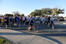 Jingle All the Way 5k participants begin running at the Taylor Chapel on Goodfellow Air Force Base, Texas, Dec. 1, 2016. The run brought our 385 people and was the kick-off to the annual tree lighting ceremony. (U.S. Air Force photo by Staff Sgt. Joshua Edwards/Released)