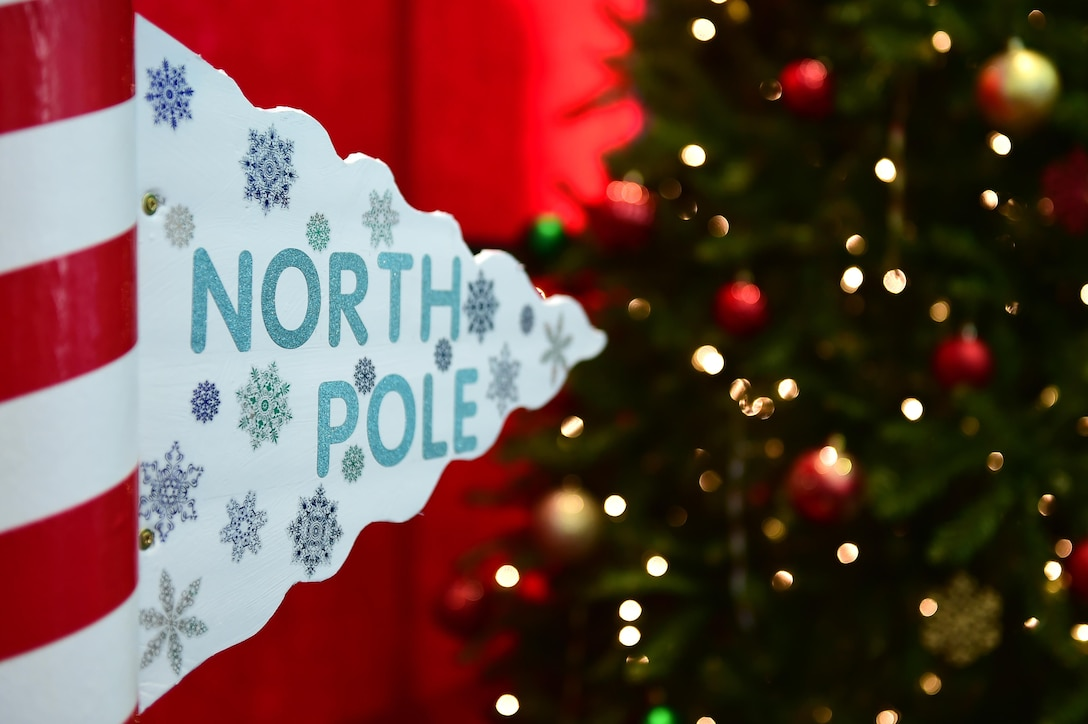 The North Pole sign points children towards Santa Claus and presents Dec. 3, 2016, at a Breakfast with Santa event on Buckley Air Force Base, Colo. The event included free breakfast, pictures with Santa Claus, and a free present for every child. (U.S. Air Force photo by Airman Jacob Deatherage/Released)