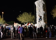 Rock climbing was available for all guests during Holiday Magic Dec. 3, 2016 at Luke Air Force Base, Ariz. The event featured bouncy houses and vouchers for free Christmas trees to Luke community members. (U.S. Air Force photo by Airman First Class Alexander Cook)