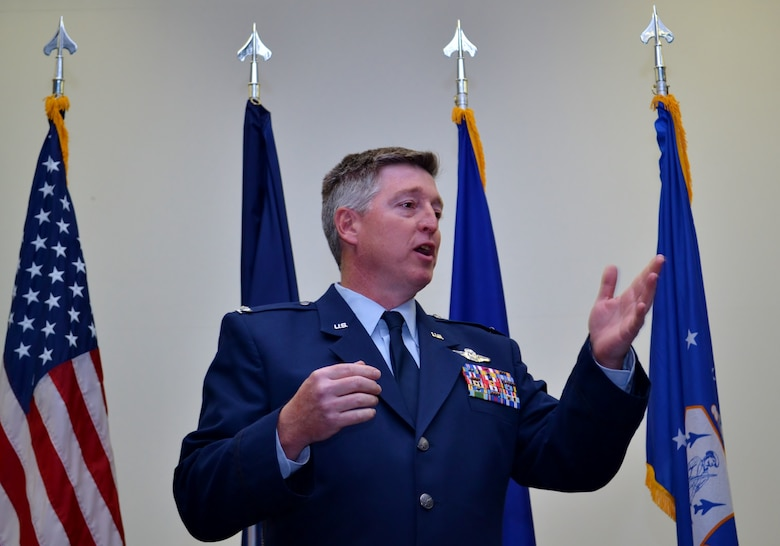 Newly-appointed 111th Operations Group  Commander Col. John O'Brien, addresses an audience of 111th Attack Wing members, family and friends for the first time after ceremoniously transitioning into his new position during the 111th OG Change of Command Ceremony conducted at the 111th Attack Wing headquarters, Horsham Air Guard Station, Pa., Dec. 3, 2016. O'Brien formerly held the position as commander of the 111th Operations Support Squadron. (U.S. Air National Guard photo by Tech. Sgt. Andria Allmond)