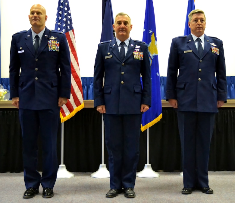 From left to right, retiring Col. Michael Shenk, Col. Howard Eissler, the 111th Attack Wing commander, and Col. John O'Brien, 111th Operations Group commander, stand at attention during the 111th OG Change of Command Ceremony conducted at the 111th Attack Wing headquarters, Horsham Air Guard Station, Pa., Dec. 3, 2016. O'Brien, a former A-10 Thunderbolt II pilot, earned the Distinguished Flying Cross during his career. (U.S. Air National Guard photo by Tech. Sgt. Andria Allmond)