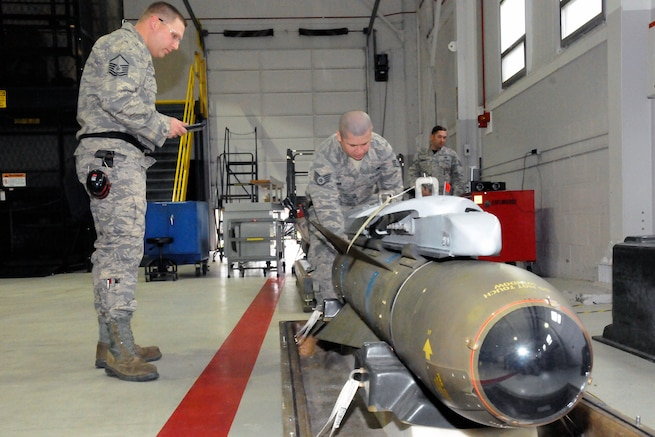 161103-Z-YW189-045 – Master Sgt. Andrew Maurer and Technical Sgt. Joshua Kacharos, weapons loaders of the 127th Maintenance Group, participates in loading a simulated bomb while being inspected and scored during a Loadeo contest at Selfridge Air National Guard Base Mich., Dec. 3, 2016. The Loadeo contest is an annual contest with competing teams that are scored for their ability to load missiles accurately and in a timely manner. (U.S. Air National Guard photo by Staff Sgt. Samara Taylor/Released)