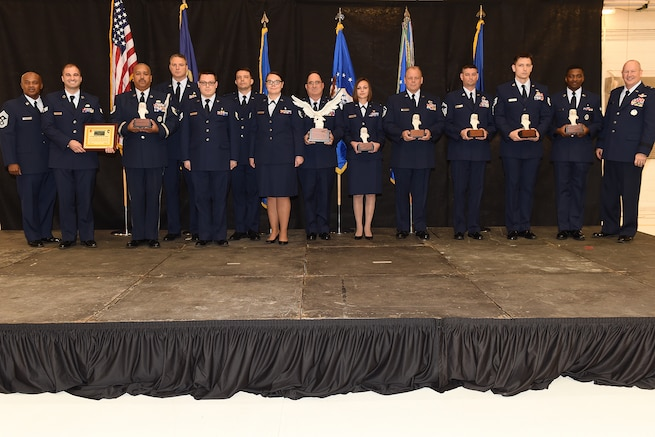 161104-Z-EZ686-038 -- Flanked between Brig. Gen. John D. Slocum, commander of the 127th Wing and Chief Master Sgt. Tony Whitehead, 127th Command Chief, stand the 127th Wing's Airmen of the Year winners with their awards following the 127th Wing Commander's Call ceremony at Selfridge Air National Guard Base, Mich., Dec. 3, 2016. Pictured are, from left, Whitehead; Senior Airman Michael Fontana, 127th Wing Safety Award; Tech. Sgt. Stuart Ingersoll, Honor Guard member of the year; the Bio-Environmental Engineering section from the 127th Medical Group, Major Mark Rausch, 1st Lt. Michael Cox, Master Sgt. Dean Klovski, Staff Sgt. Audrey Carlstrom, and Staff Sgt. Brandon Reif, Commander's Trophy winners; 1st Lt. Paige Campbell, Company Grade Officer of the Year; Master Sgt. Robin Cleaver, First Sergeant of the Year; Senior Master Sgt. Eric Bates, Senior Non-Commissioned Officer of the Year; Technical Sgt. Drew Reynolds, Non-Commissioned Officer of the Year; Airman First Class Clifford Mua, Airman of the Year; and Slocum. (U.S. Air National Guard photo by MSgt. David Kujawa / Released)