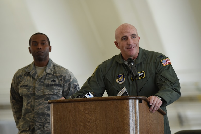 Col. Kenneth Moss, 374th Airlift Wing commander, speaks at the 2016 Operation Christmas Drop Push Ceremony Dec. 6, 2016, at Andersen Air Force Base, Guam. This is the second year of Operation Christmas Drop where aircrews from the Japan Air Self-Defense Force, Royal Australian Air Force and U.S. Air Force come together to train airlift capabilities for peace and wartime. (U.S. Air Force Photo by Airman 1st Class Jacob Skovo)