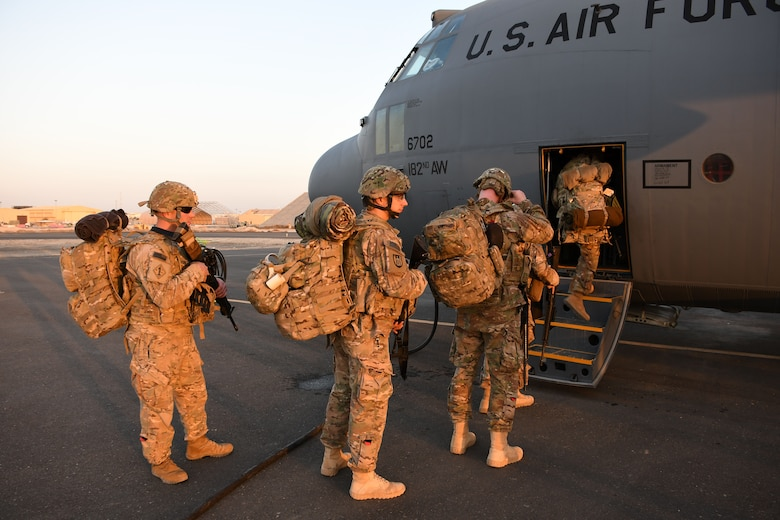U.S. service members board a C-130H Hercules at an undisclosed location in Southwest Asia Dec. 4, 2016. Over the last three months, the 386th has moved an average of nearly 8,000 passengers a month throughout the U.S. Central Command area of responsibility in support of Operation Inherent Resolve. (U.S. Air Force photo/Senior Airman Andrew Park)