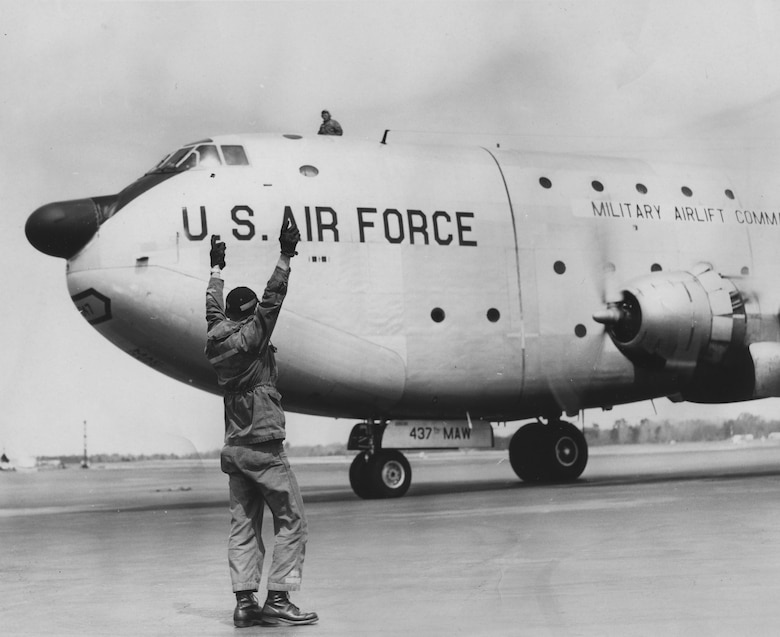 An Airman marshalls a C-124 Globemaster II on Charleston Air Force Base, South Carolina in the 1960s. The C-124 was based here from 1958 until 1969. A static display of the C-124 Globemaster II stands at the Air Park here.
