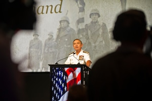 """Navy Adm. Harry B Harris Jr., commander of U.S. Pacific Command, speaks at a tribute for Japanese-American veterans who served in World War II, in Honolulu, Dec. 5, 2015. The """"Fighting Two Wars"""" event honored the bravery and loyalty of the Japanese Americans who served after Pearl Harbor, even in the face of discrimination and distrust. DoD photo by Lisa Ferdinando"""