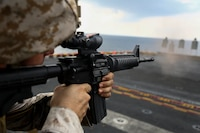 Marines assigned to Combat Logistics Battalion, 22nd Marine Expeditionary Unit, participate in a live fire weapons shoot on the flight deck of the amphibious assault ship USS Wasp (LHD 1) on November 27, 2016. The 22nd MEU, deployed with the Wasp Amphibious Ready Group, is conducting naval operations in support of U.S. national security interests in Europe.