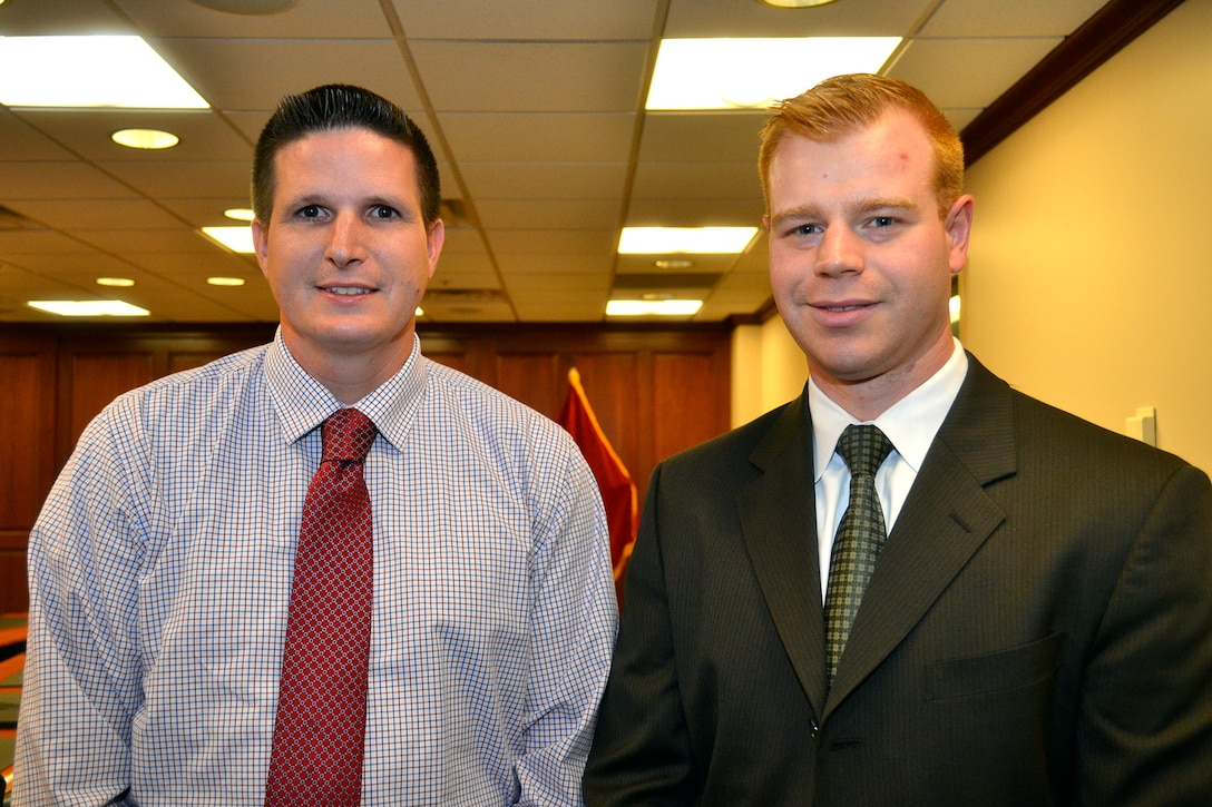 Peter Stupak (left), a management and program analyst with the Continuous Process Improvement office, and David Mourar (right), a contracting officer with the Medical supply chain, were certified as Lean Six Sigma green belts after successfully completing LSS projects that saved DLA Troop Support thousands of dollars and dozens of hours.