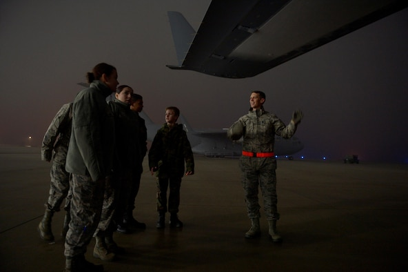 Lt. Col. Christopher Ott, right, 726th Air Mobility Squadron, talks about a C-17 Globemaster III to Civil Air Patrol cadets from Squadron 126 at Spangdahlem Air Base, Germany, Dec. 1, 2016. The CAP youth program trains them to be leaders and offers aerospace education. (U.S. Air Force photo by Staff Sgt. Jonathan Snyder)