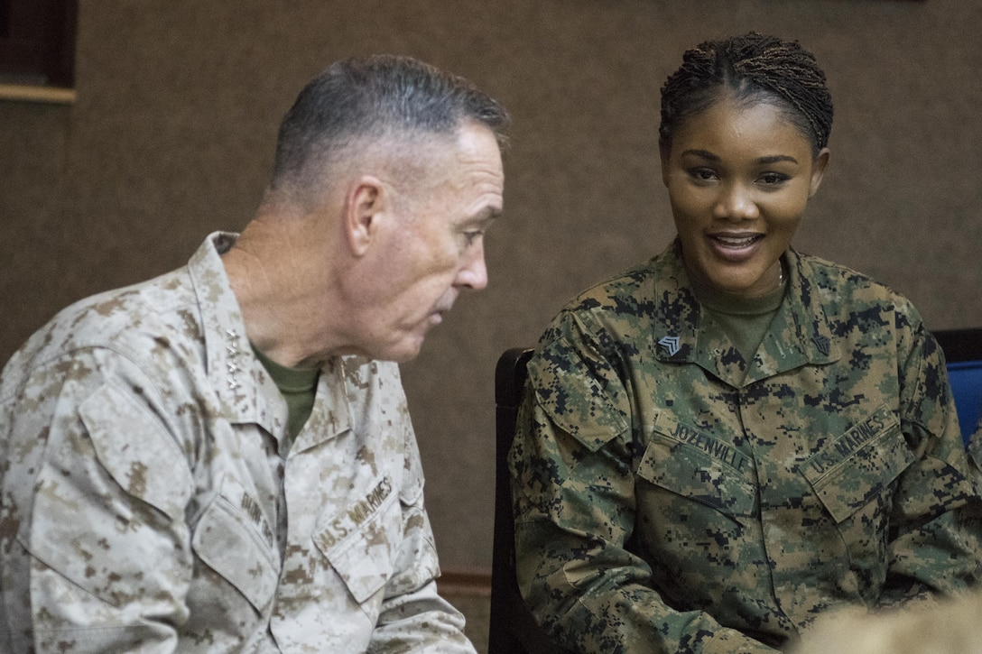 Marine Corps Gen. Joe Dunford, chairman of the Joint Chiefs of Staff, speaks to a service member during his visit to Incirlik Air Base in Turkey.