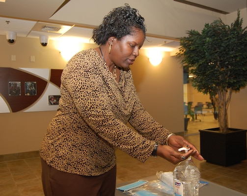 Defense Contract Management Agency employee Yvette McDuffie, a management analyst in the Contracts Directorate, uses hand sanitizer during the simulated pandemic influenza exercise Nov. 15-17 at Fort Lee, Virginia. (DCMA photo by Tonya Johnson)