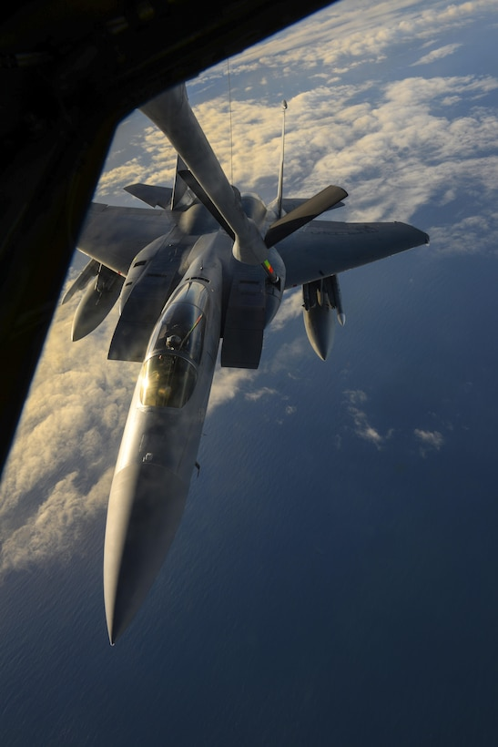 A U.S. Air Force F-15D Eagle, assigned to the 48th Fighter Wing from RAF Lakenheath, England, receives fuel from a KC-135 Stratotanker assigned to the 349th Air Mobility Wing from Beale Air Force Base, Calif., Dec. 2, 2016, over the Atlantic Ocean. U.S. Air Force Col. Thomas Torkelson, 100th Air Refueling Wing commander at RAF Mildenhall, England, flew in an F-15 as a part of a familiarization flight to enable him to experience what it's like to receive fuel from a KC-135. (U.S. Air Force photo by Staff Sgt. Micaiah Anthony)