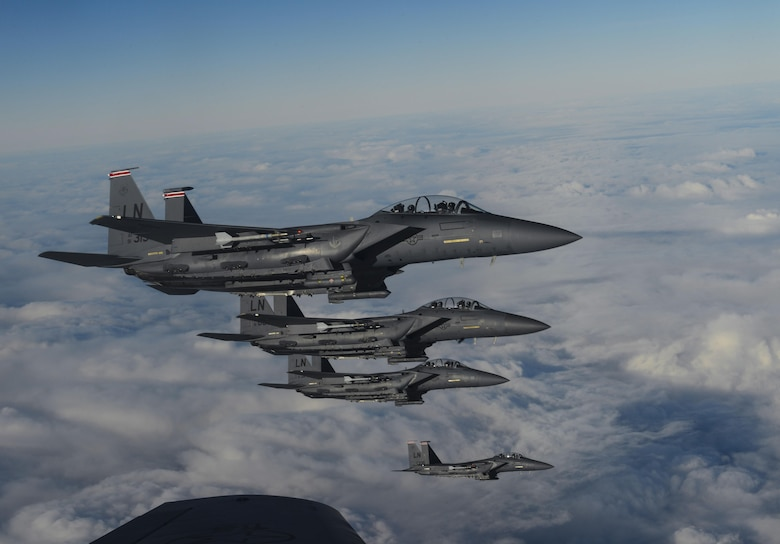 U.S. Air Force F-15D Eagles assigned to the 48th Fighter Wing from RAF Lakenheath, England, fly in formation off of the wing of a KC-135 Stratotanker assigned to the 349th Air Mobility Wing from Beale Air Force Base, Calif., Dec. 2, 2016, over the Atlantic Ocean. The F-15 Eagle is an all weather, extremely maneuverable tactical fighter designed to permit the Air Force to gain and maintain air supremacy over the battlefield. (U.S. Air Force photo by Staff Sgt. Micaiah Anthony)