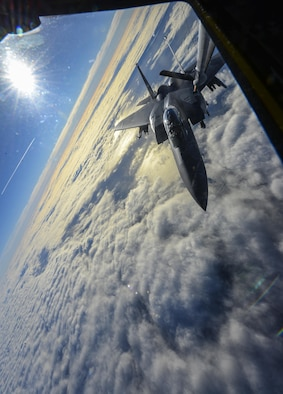 A U.S. Air Force F-15D Eagle assigned to the 48th Fighter Wing from RAF Lakenheath, England, takes fuel from a KC-135 Stratotanker assigned to the 349th Air Mobility Wing from Beale Air Force Base, Calif., Dec. 2, 2016, over the Atlantic Ocean. U.S. Air Force Col. Thomas Torkelson, 100th Air Refueling Wing commander at RAF Mildenhall, England, flew with the 48th FW to experience their mission of providing worldwide responsive combat air power and support. (U.S. Air Force photo by Staff Sgt. Micaiah Anthony)