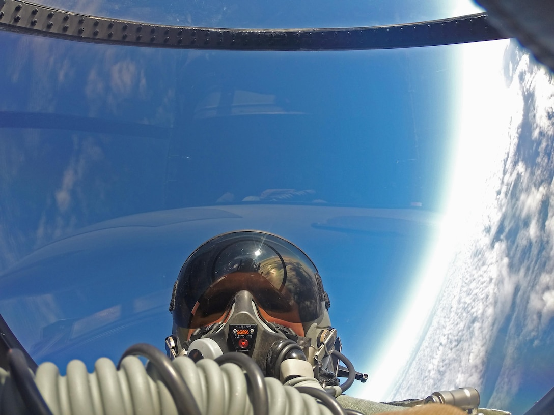 """U.S. Air Force Col. Thomas Torkelson, 100th Air Refueling Wing commander at RAF Mildenhall, England, takes a """"selfie"""" in the back of an F-15D Eagle assigned to the 48th Fighter Wing from RAF Lakenheath, England, Dec. 2, 2016, over the Atlantic Ocean. Torkelson flew with the 48th Fighter Wing to experience first-hand their role in securing peace through strength. (U.S. Air Force photo by Col. Thomas Torkelson)"""