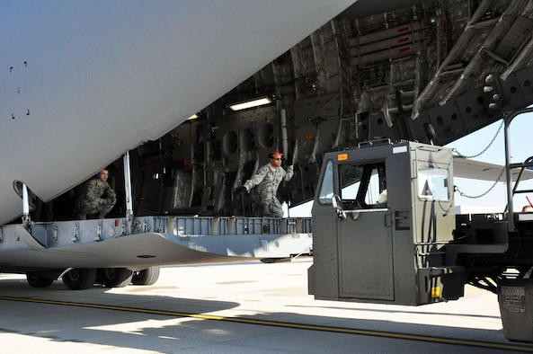 Airmen from the 87th Aerial Port Squadron unload cargo from a 445th Airlift Wing C-17 Globemaster III November 6, 2016 on the west ramp at Wright-Patterson Air Force Base, Ohio. (U.S. Air Force photo/Staff Sgt. Rachel Ingram)