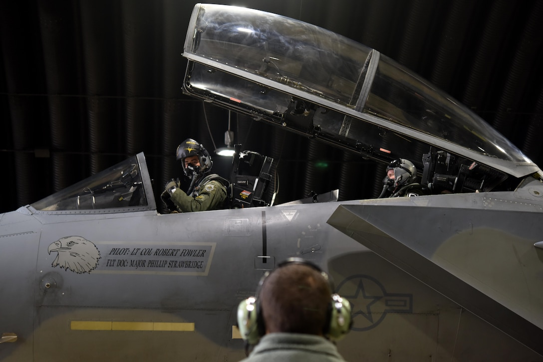 A U.S. Air Force pilot from the 493rd Fighter Squadron prepares for a flight at RAF Lakenheath, England, Dec. 2, 2016, on RAF Lakenheath, England. Flying with the pilot was U.S. Air Force Col. Thomas Torkelson, 100th Air Refueling Wing commander. Torkelson flew in an F-15D Eagle to see the air refueling process from the eyes of a fighter pilot. (U.S. Air Force photo/Airman 1st Class Eli Chevalier)