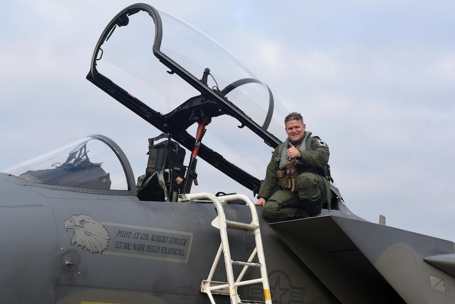 U.S. Air Force Col. Thomas Torkelson, 100th Air Refueling Wing commander, poses for a photo after his flight in an F-15D Eagle Dec. 2, 2016, on RAF Lakenheath, England. Torkelson had the chance to view the air refueling process from the eyes of the fighter pilot. (U.S. Air Force photo/Airman 1st Class Eli Chevalier)