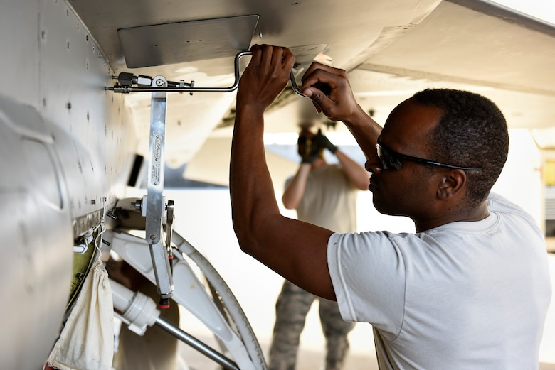 U.S. Air Force Senior Airman Brian Mathus, an aircraft structural maintenance technician assigned to the 112th Expeditionary Fighter Squadron, performs maintenance on an F-16 Fighting Falcon Feb. 18, 2016, during exercise COPE NORTH 16 at Andersen Air Force Base, Guam. CN16 is an annual exercise which serves as a keystone event to promote stability and security throughout the Indo-Asia-Pacific by enabling regional forces to hone vital readiness skills. (U.S. Air National Guard photo by Staff Sgt. Shane Hughes/Released)