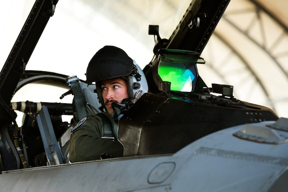 U.S. Air Force Capt. Drew Hauber, an F-16 Fighting Falcon pilot assigned to the 112th Expeditionary Fighter Squadron, conducts preflight checks Feb. 22, 2016, during exercise COPE NORTH 16 at Andersen Air Force Base, Guam. Training exercises such as CN16, allow the U.S., Japan and Australia air forces to develop combat capabilities, enhancing air superiority, electronic warfare, air interdiction, tactical airlift and aerial refueling. (U.S. Air National Guard photo by Staff Sgt. Shane Hughes/Released)