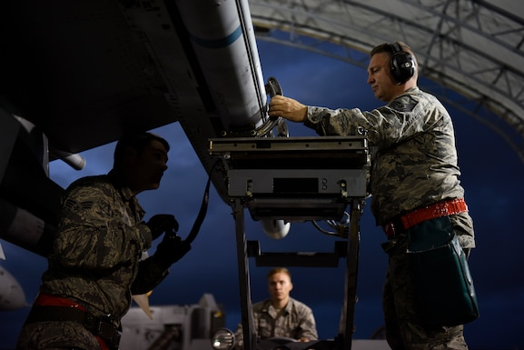 U.S. Air Force Senior Airman Justin Mattoni, Staff Sgt. Devon Childress and Master Sgt. Davis Mills, a weapons load team assigned to the 112th Expeditionary Fighter Squadron, conduct a cross-load Feb. 22, 2016, during exercise COPE NORTH 16 at Andersen Air Force Base, Guam. Training exercises such as CN16, allow the U.S., Japan and Australia air forces to develop combat capabilities, enhancing air superiority, electronic warfare, air interdiction, tactical airlift and aerial refueling. (U.S. Air National Guard photo by Staff Sgt. Shane Hughes/Released)