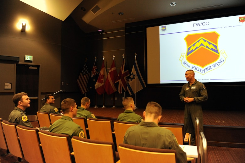 Brig. Gen. Brook Leonard, 56th Fighter Wing commander, welcomes the first class of F-35 Lightning II student pilots to train under the newly made F-35 syllabus Dec. 5, 2016 in the F-35 Academic Training Center auditorium at Luke Air Force Base, Ariz. The syllabus was created to teach pilots without prior fighter jet experience how to fly the F-35. (U.S. Air Force photo by Staff Sgt. Grace Lee) (Released)