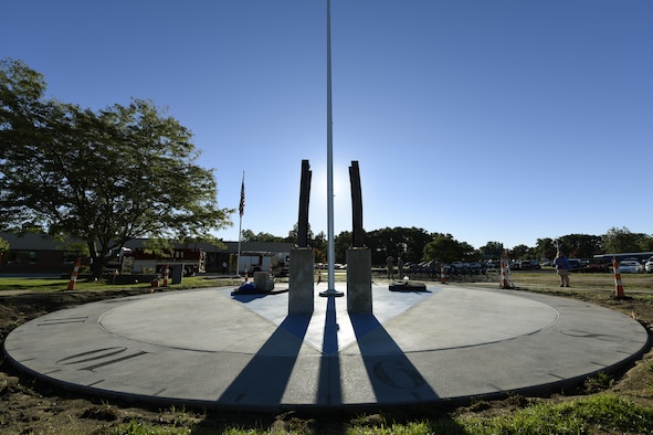 The shadow of the flagpole falls across the clock face of the Northwest Ohio 9/11 Memorial located at the center of the 180th Fighter Wing in Swanton, Ohio, on the morning of the 15th anniversary of the attacks on Sept. 11, 2001, marking the exact time the first plane struck the north tower of the World Trade Center. The monument memorializes the loss of nearly 3,000 lives during the attacks and since. (U.S. Air National Guard photo by Staff Sgt. Shane Hughes)