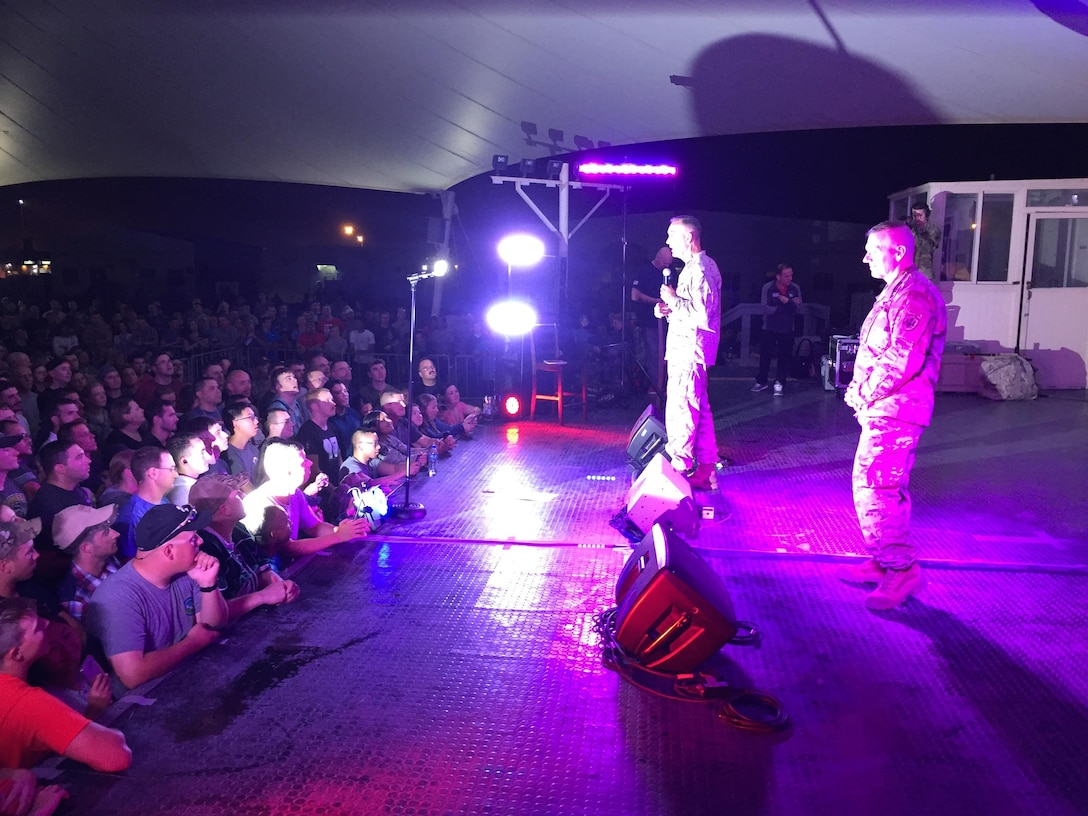 Chairman of the Joint Chiefs of Staff Marine Corps Gen. Joe Dunford and his senior enlisted advisor, Army Command Sgt. Maj. John W. Troxell, speak to the troops before the USO show at al Udeid Airt Base, Qatar, Dec. 6, 2016. DoD photo by Jim Garamone