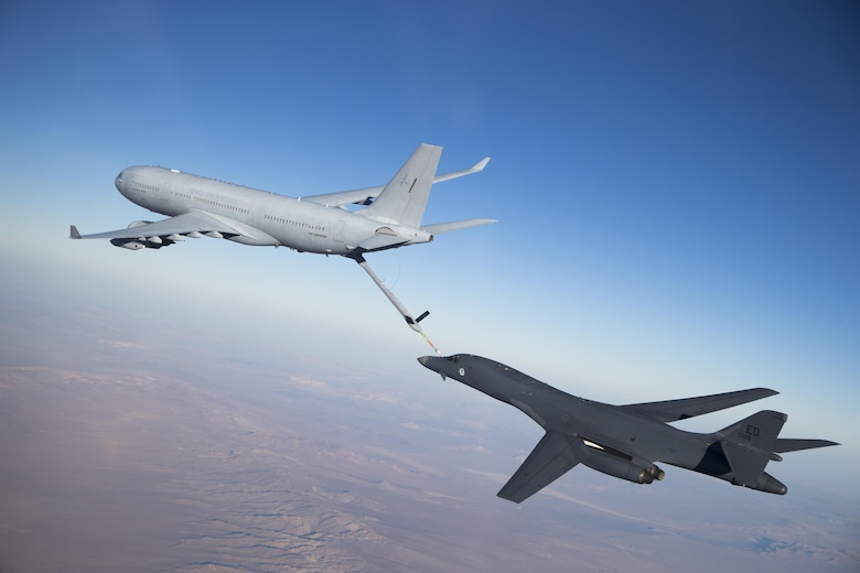 A Royal Australian Air Force K-30A refuels a U.S. Air Force B-1 Bomber as part of the Coalition Aerial Refueling Initiative.
