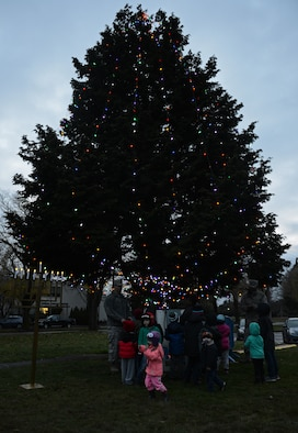 Team McChord families surround the holiday tree during the McChord Field Annual Tree Lighing Ceremony Dec. 5, 2016 at Joint Base Lewis-McChord, Wash. Santa Claus and his elves visited children, while families participated in several events following the ceremony. (U.S. Air Force photo/Senior Airman Divine Cox)