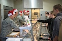 Wing leaders serve Airmen lunch at the 182nd Airlift Wing in Peoria, Ill., Dec. 3, 2016. Wing leadership served lunch to thank all the Airmen on the installation for a job well done and to wish them a happy and safe holiday. (U.S. Air National Guard photo by Tech. Sgt. Lealan Buehrer)