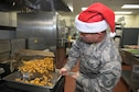 U.S. Air Force Master Sgt. Jeremiah Williams, a services specialist with the 182nd Force Support Squadron, Illinois Air National Guard, prepares French fries at the December holiday meal in Peoria, Ill. Dec. 3, 2016. The squadron's services flight creates special lunch menus to honor holidays occurring during the month. (U.S. Air National Guard photo by Tech. Sgt. Lealan Buehrer)