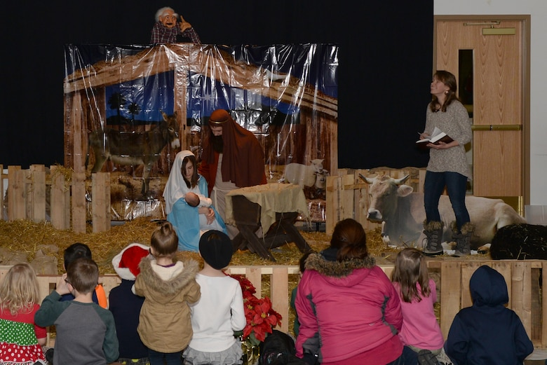 Children watch a Christmas skit at the Base Chapel Dec. 2, 2016, on Eielson Air Force Base, Alaska. The skit included a live nativity scene and a story about Christmas. (U.S. Air Force photo by Airman Eric M. Fisher)