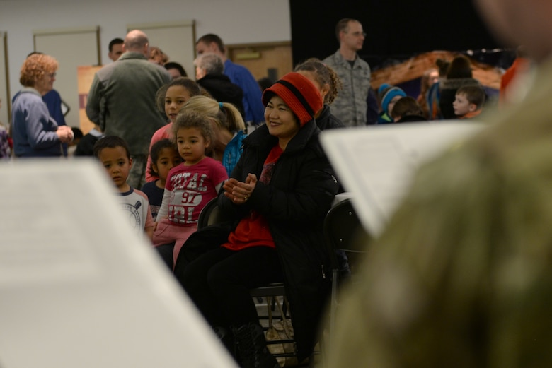 Members of the audience listen to music played during the annual 354th Fighter Wing Chapel's Christmas Tree Lighting Dec. 2, 2016, at Eielson Air Force Base, Alaska. The music was provided by the 9th Army Band out of Fort Wainwright, Alaska. (U.S. Air Force photo by Airman Eric M. Fisher)