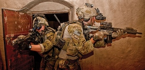 Coalition security forces conduct a surgical strike raid on rooms housing Taliban operatives.