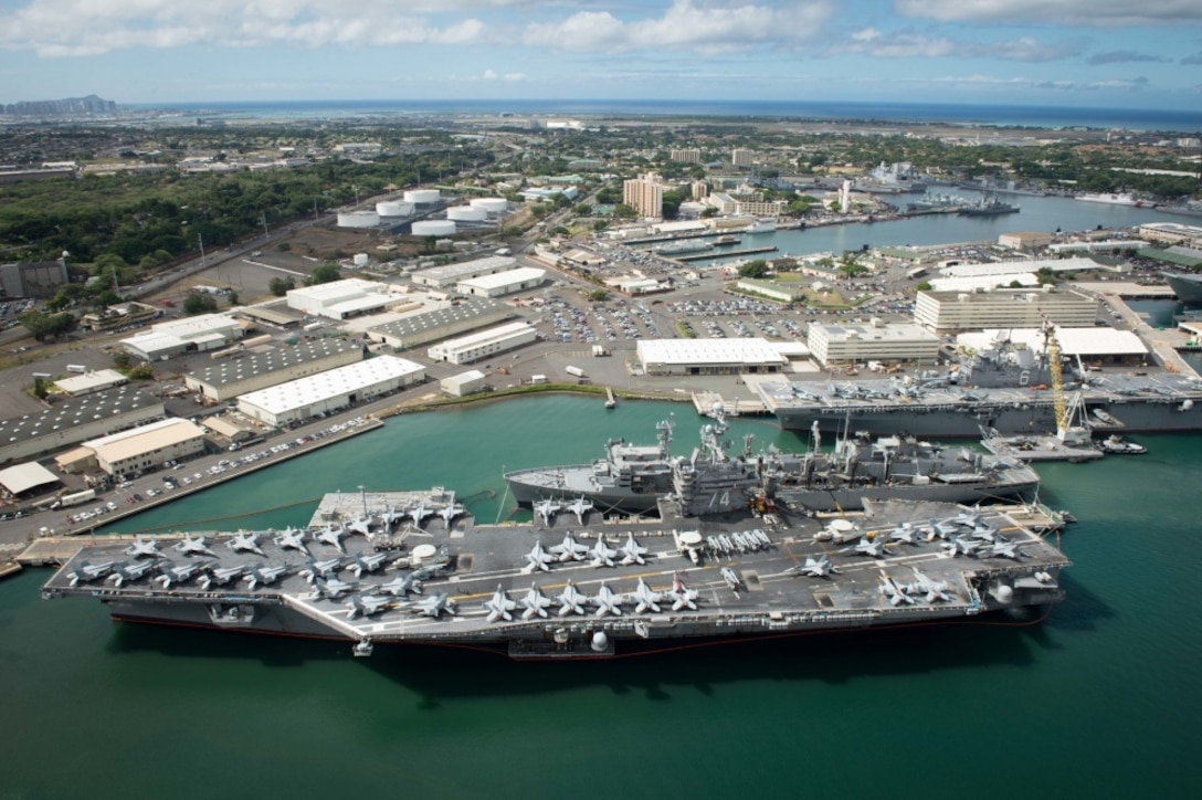 An aerial view of ships moored at Joint Base Pearl Harbor-Hickam for Rim of the Pacific 2016. Twenty-six nations, more than 40 ships and submarines, more than 200 aircraft, and 25,000 personnel are participating in RIMPAC from June 30 to Aug. 4, in and around the Hawaiian Islands and Southern California. (U.S. Navy Combat Camera photo by Mass Communication Specialist First Class Ace Rheaume/Released)