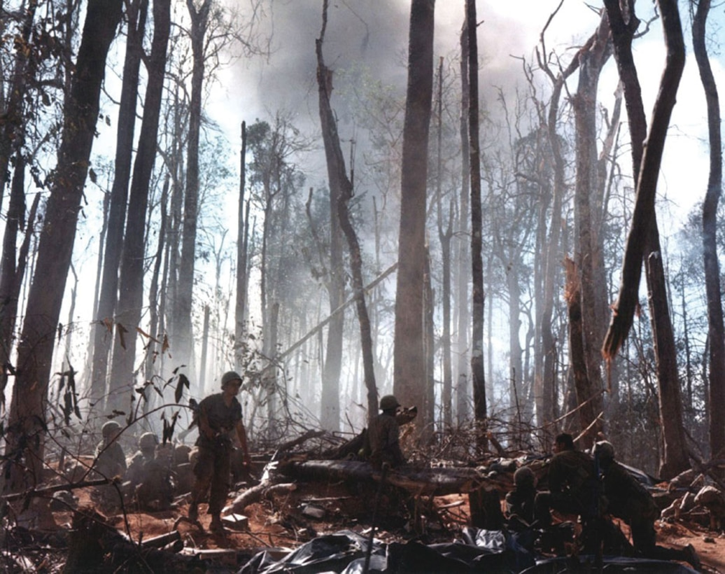 American troops destroying enemy bunkers in the highlands of Vietnam during the Vietnam War.