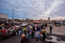 More than 500 people watch as floats drive by during a Christmas Parade, Dec. 3, 2016, in Downtown Goldsboro, North Carolina. The parade began with Col. Christopher Sage, 4th Fighter Wing commander, who was the grand marshal of the parade. (U.S. Air Force photo by Airman Shawna L. Keyes)