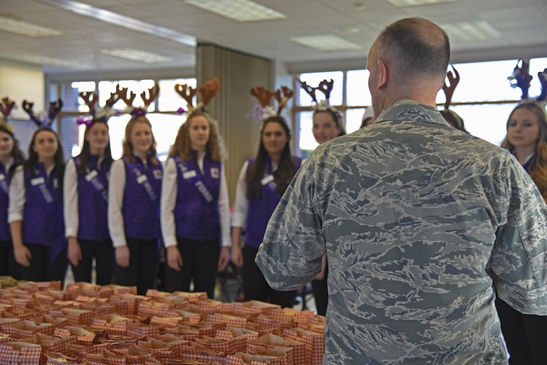 Col. Ryan Samuelson, 92nd Air Refueling Wing commander, speaks with 14 Spokane Lilac Festival Princesses during the annual Operation Cookie Drop Dec. 6, 2016, at Fairchild Air Force Base. The Lilac Princesses were joined by the Officer's Spouses Club in packing more than 500 bags for Airmen living in the dormitories. (U.S. Air Force photo/Senior Airman Mackenzie Richardson)