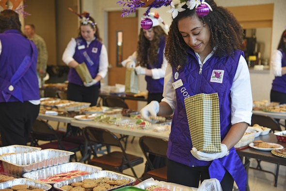 August Corppetts, Spokane Lilac Festival Princess and Gonzaga Preparatory School student, fills a bag with homemade cookies during the annual Operation Cookie Drop Dec. 6, 2016, at Fairchild Air Force Base. The Spokane Lilac Festival Princesses partnered with Officer's Spouses Club to pack nearly 500 bags with cookies for Fairchild Airmen living in the dormitories. (U.S. Air Force photo/Senior Airman Mackenzie Richardson)