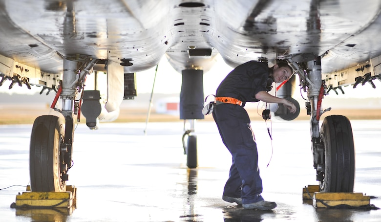 U.S. Air Force Airman 1st Class Morgan Cisna, an F-15E Strike Eagle crew chief with the 391st Aircraft Maintenance Squadron, Mountain Home Air Force Base, Idaho, inspects the underside of an F-15E before takeoff at Tyndall AFB, Fla., Dec. 5, 2016. The F-15Es are taking part in Checkered Flag 17-1, a large scale total force integration exercise that gives legacy and fifth-generation aircraft a chance to train together in a simulated deployed environment. (U.S. Air Force photo by Senior Airman Dustin Mullen/Released)