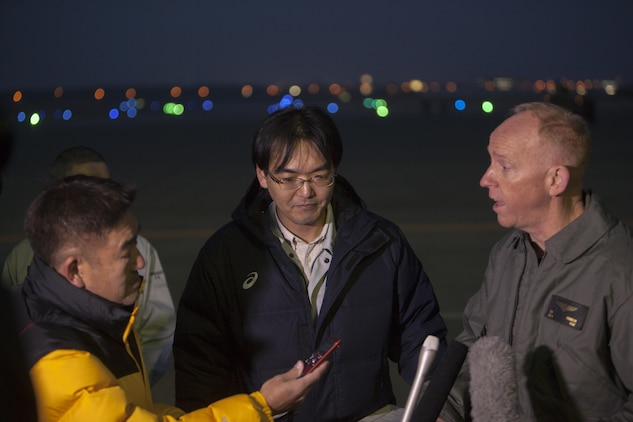 A Japanese local media reporter, left, questions U.S. Marine Corps Lt. Col. John D. Ferguson, commanding officer of Marine Attack Squadron (VMA) 542, right, after the arrival of the squadrons AV-8B Harriers for the Aviation Training Relocation Program at Chitose Air Base, Japan, Dec. 5, 2016. Following the arrival of the squadron's Harriers, a press conference was held to acknowledge questions pertaining to the aircraft and the ATR. (U.S. Marine Corps photo by Cpl James A. Guillory)