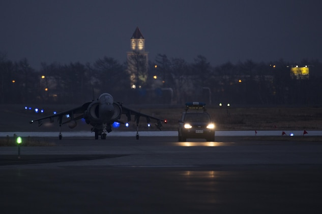 A U.S. Marine Corps AV-8B Harrier with Marine Attack Squadron (VMA) 542 is escorted to the flight line after landing at Chitose Air Base, Japan, Dec. 5, 2016. Four Harriers flew from Atsugi to partake in the Aviation Relocation Training Program. Following the arrival of the squadron's Harriers, a press conference was held to acknowledge questions pertaining to the aircraft and the ATR. (U.S. Marine Corps photo by Lance Cpl. Joseph Abrego)